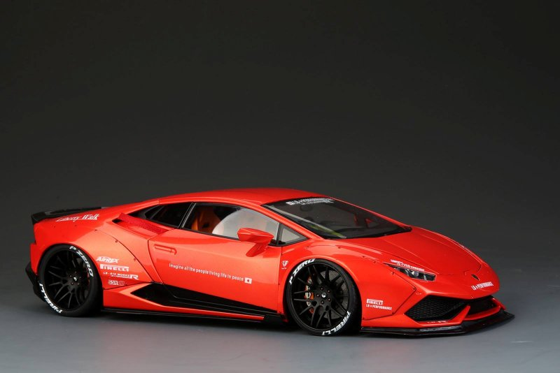 the photos the model does look delicious dressed in all orange with black wheels are accent bits fully opening motor and interior add to the realism